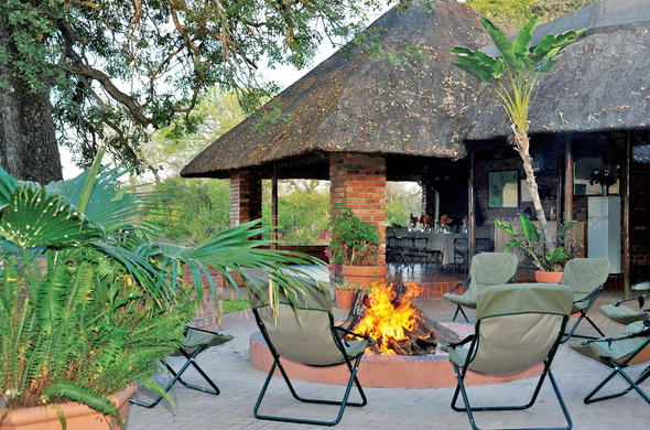 Gather around the boma on the Djuma Galago Camp patio.
