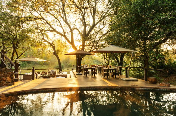 Dulini Lodge has a deck and outdoor lounge area.