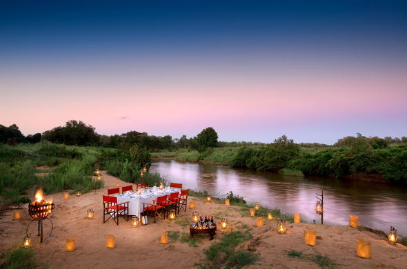 Dine on the banks of the Sabie River.