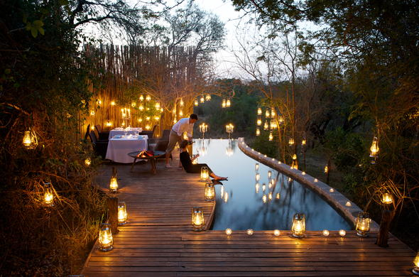 Romantic dinner around the Londolozi Pioneer Camp pool.