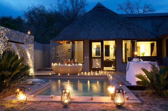 Candles and lanterns around the pool and outdoor bath.