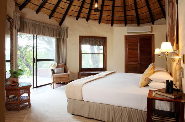 Enjoy cosy thatched roof accommodation at Mala Mala Main Camp.