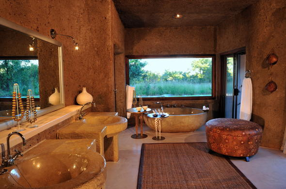 Amber Suite bathroom at Sabi Sabi Earth Lodge eco friendly safari.