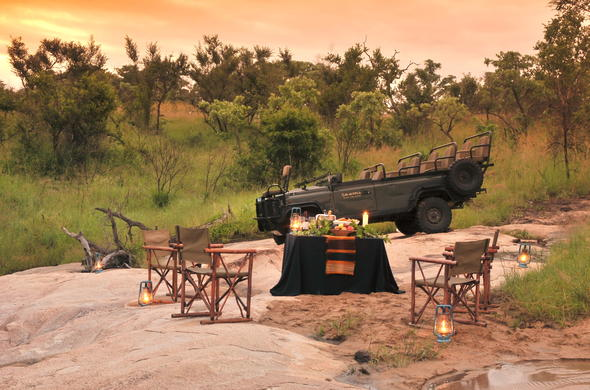 Romantic sundowner stop in the African bush.