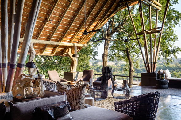 Chic guest lounge with unique decor at Singita Boulders Lodge.